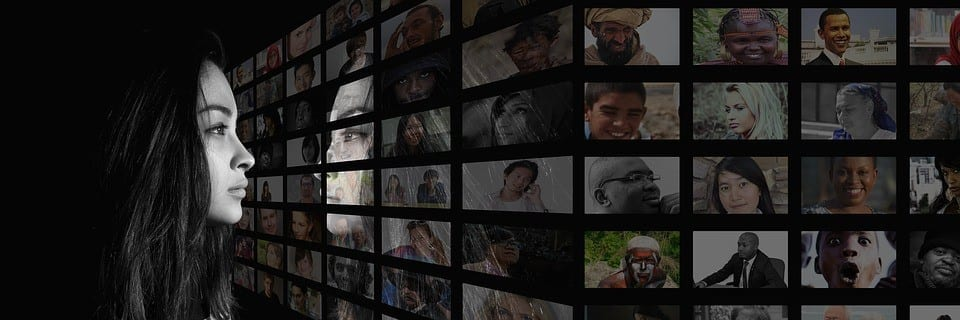 Woman Looking at Screen with Faces