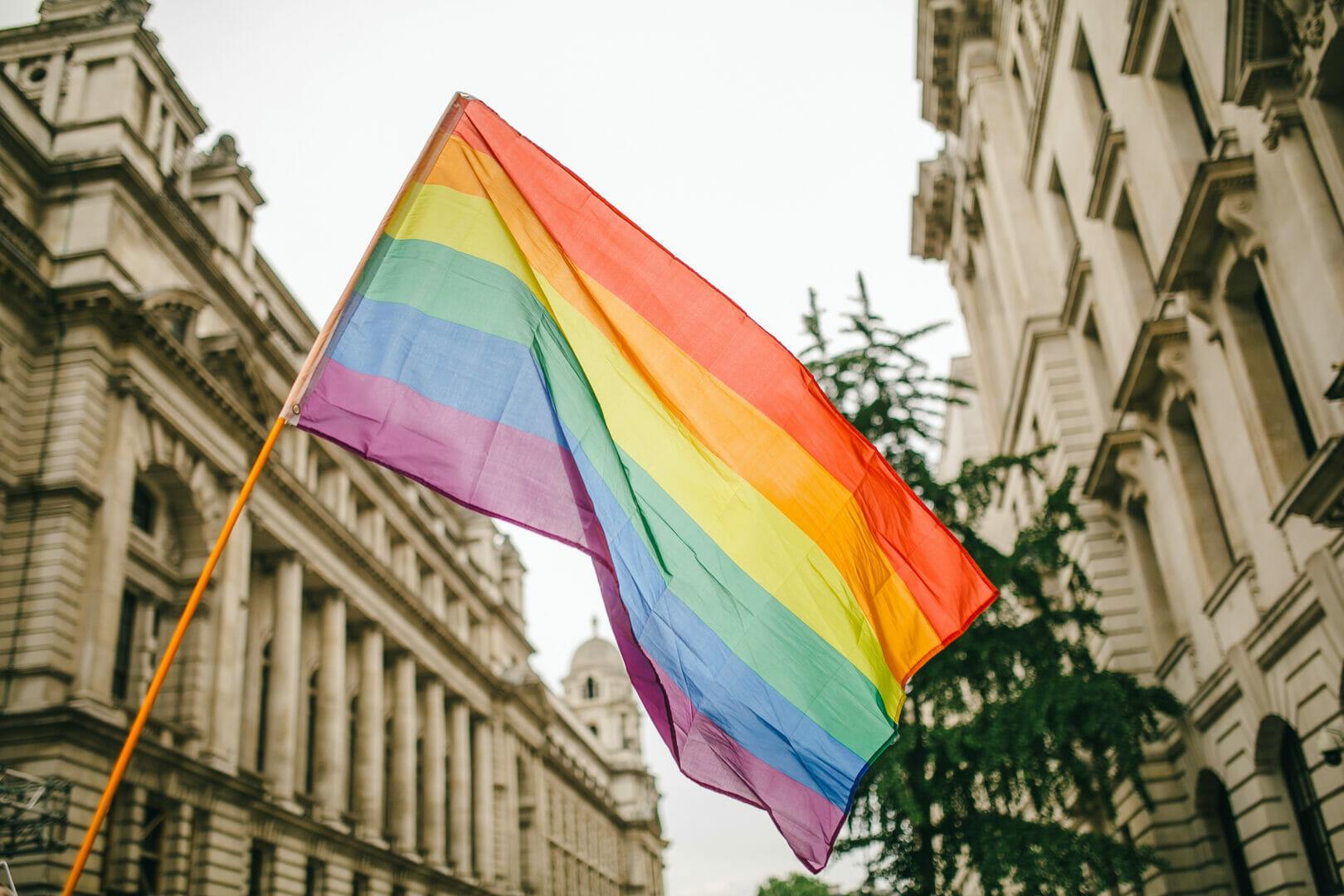 pride flag between buidlings